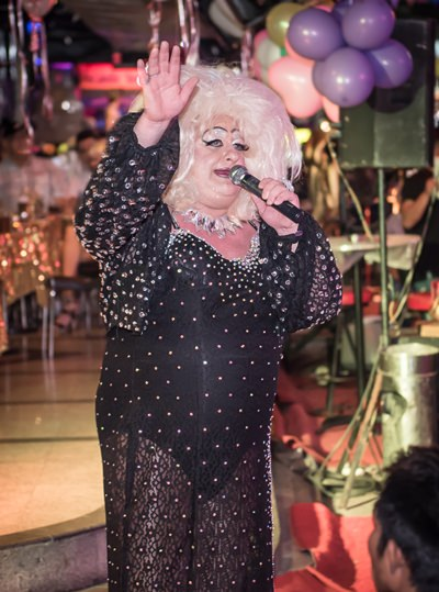 Davina Sparkle performs live for the street show during World AID's Day.