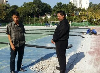Directors of Pattaya School 9 follow up on the progress of the new football stadium.