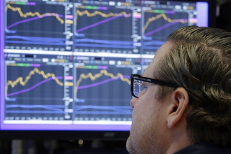 In this Monday, Dec. 4, 2017, file photo, specialist Gregg Maloney works at his post on the floor of the New York Stock Exchange. The stock market had a banner year overall, but there were plenty of big winners, and big losers, among individual U.S. companies in 2017. (AP Photo/Richard Drew, File)