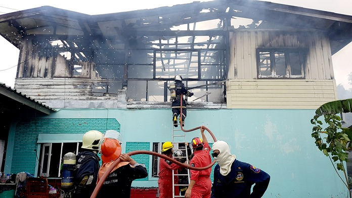 A forgotten candle is being blamed for a fire that destroyed an elderly Sattahip woman's house. It took firefighters nearly an hour to control the blaze.