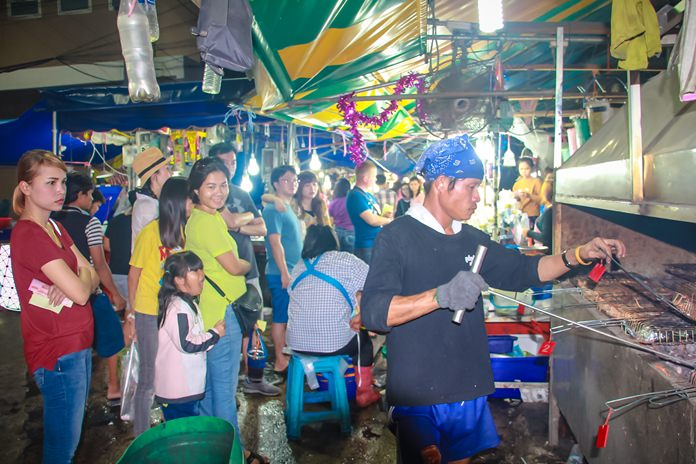 Local seafood vendors say their business is doing great, with three times the income of a normal day/night.