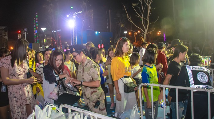 Security is tight as all concert goers are scanned and searched for potential weapons and other illegal contraband.