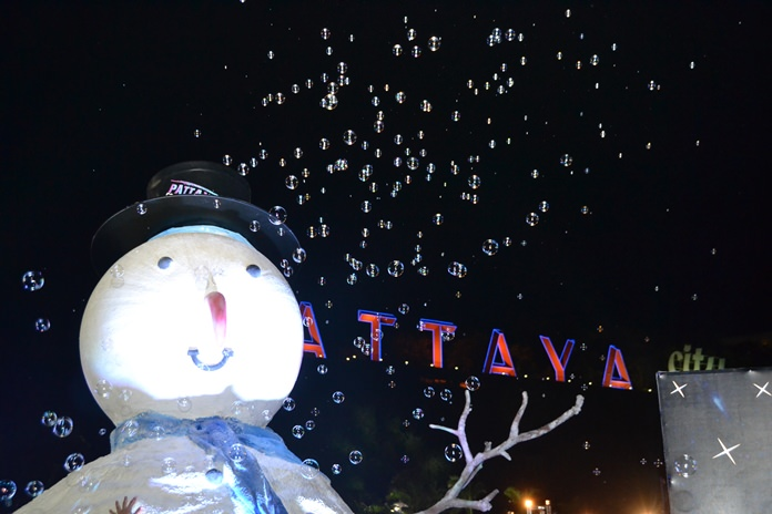 This snowman is enjoying his tiny bubbles, in the air.