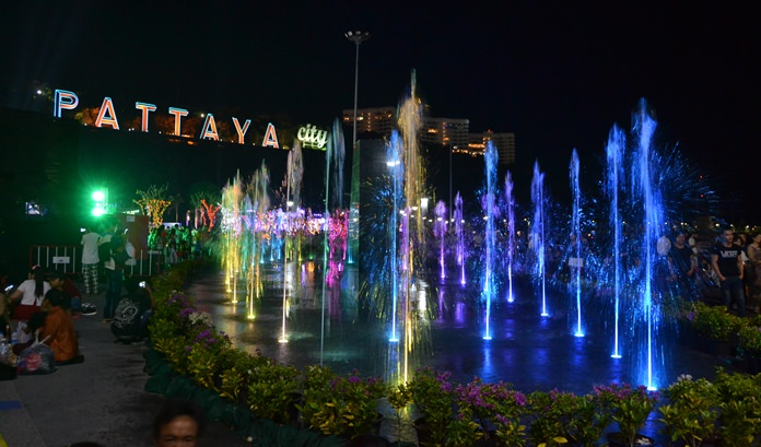 The new water fountain lights up the night.