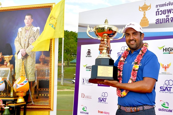 Shiv Kapur of India holds up the champion's trophy after winning the Royal Cup golf tournament at Phoenix Gold Golf and Country Club in Pattaya, Sunday, December 31.