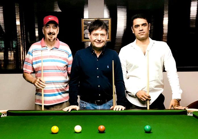 Jimmy White (centre) is flanked by Mike Tandy (left) and Infinity Snooker Club owner Meysam Amini during the opening of the club's new star matchroom tournament table, Friday, December 29.