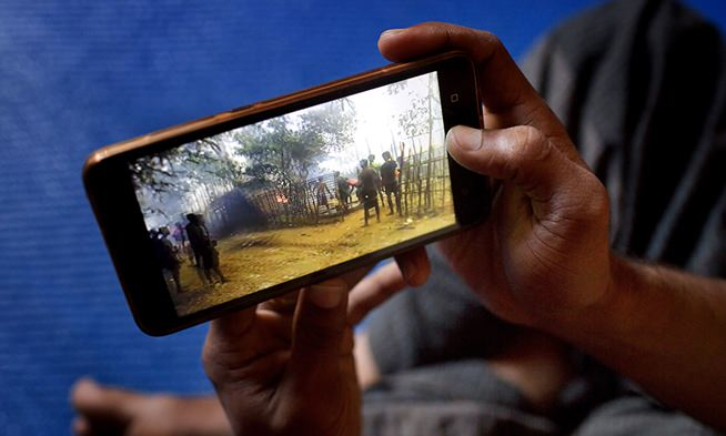 For many Rohingya living in refugee camps in Bangladesh, all that remains of their old lives in Myanmar are memories captured in photos and videos on their cellphones. (AP Photo/A.M. Ahad)