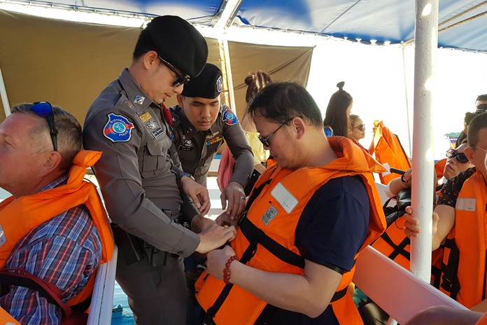 Officers at Pattaya's sea rescue center check to make sure water safety gear meets all the required standards.