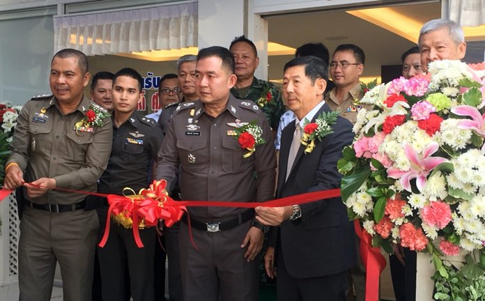 Chonburi's police commander, Pol. Maj. Gen. Nantachart Supamongkol cuts the ribbon on the newly renovated Pattaya police station.