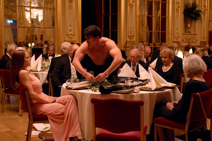 """This image shows Terry Notary (center) in a scene from """"The Square."""" (Magnolia Pictures via AP)"""