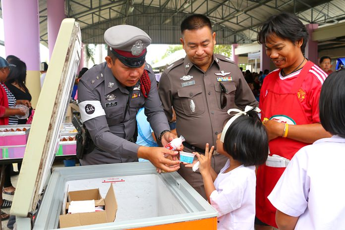 """I'll take two, please,"" this little one says at the free ice cream cooler in Wat Najomtien School."