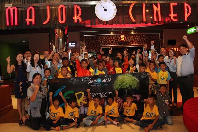 Kemikapak Thangjithikhun, assistant hotel training manager, and Phumpich Dabbarans bring over 40 children from Baan Jing Jai out to the movies.