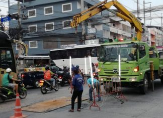 Road workers repair a collapsed section of Thepprasit Road following complaints from locals.