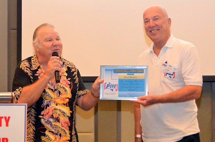 MC Roy Albiston presents Brad Walker with the PCEC's Certificate of Appreciation.