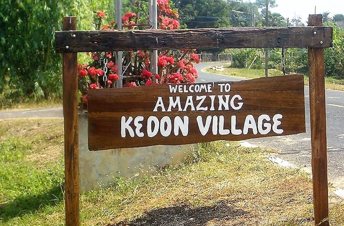 This is the sign that Brad Walker made and placed at the entrance of Kedon Village in Surin Province.