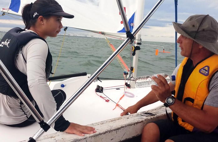 Thailand sailing coach Dimitrios Theodorakis (right) gives a briefing to Janisara Romanyk on the final day of the championships.