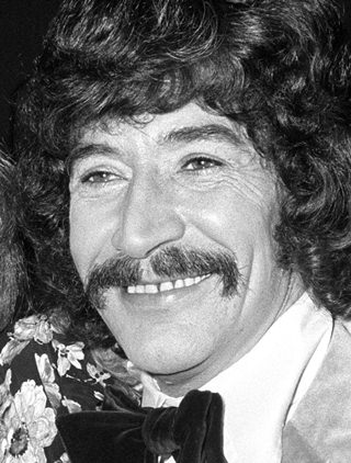 This Jan. 4, 1973 photo shows British actor Peter Wyngarde. (PA, File via AP)