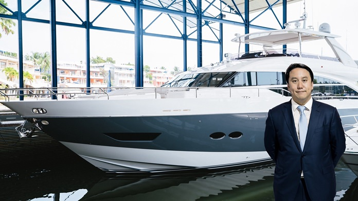 Vrit Yongsakul, Managing Director of Boat Lagoon Yachting Co., Ltd., is photographed with a Princess yacht.