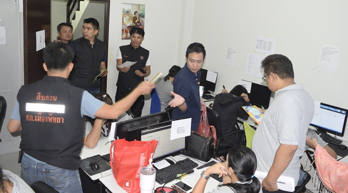 Police raided four Pattaya-area call centers and arrested more than a dozen Thais and Russians on charges they were illegally selling beauty products, health supplements and insurance.