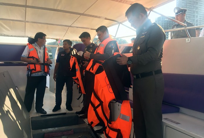 Chonburi Deputy Gov. Chaichan Iamcharoen (left) and local officials inspect boats at Bali Hai Pier to make sure that safety standards are shipshape.