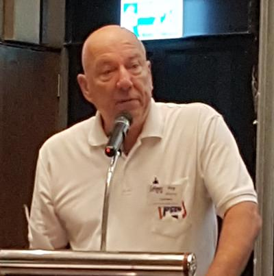 MC Roy Albiston welcomes members and guests before introducing Mechai Viravaidya to talk about a unique school for student and community learning in Buriram.