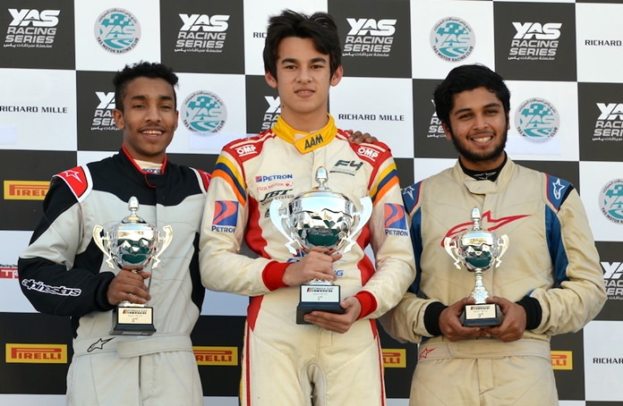 Kane Shepperd (center) stands on the podium after winning the Formula 4 South East Asia and Formula Gulf Championship race event in Abu Dhabi, Saturday, January 20.
