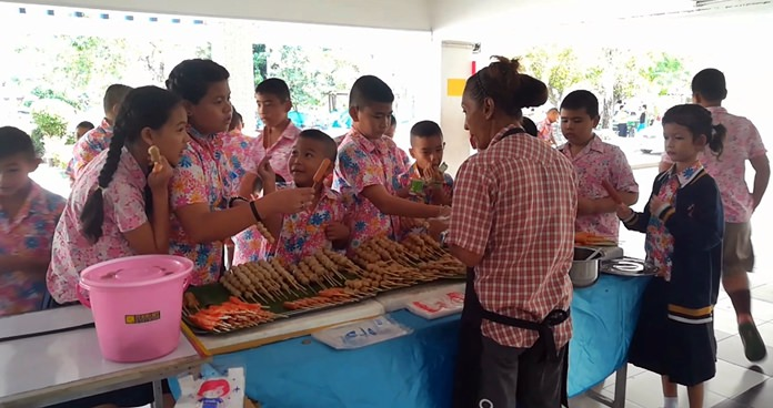 """Local disabled residents and their families were given a chance to earn some extra cash while kids got treats at a """"happy market"""" at Nongprue Kindergarten."""