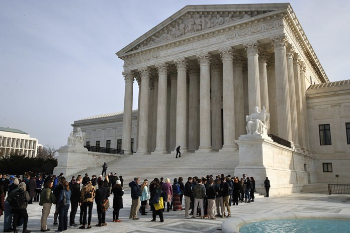 The Supreme Court is agreeing to decide the legality of the latest version of President Donald Trump's ban on travel to the United States by residents of six mostly Muslim countries. (AP Photo/Jacquelyn Martin)