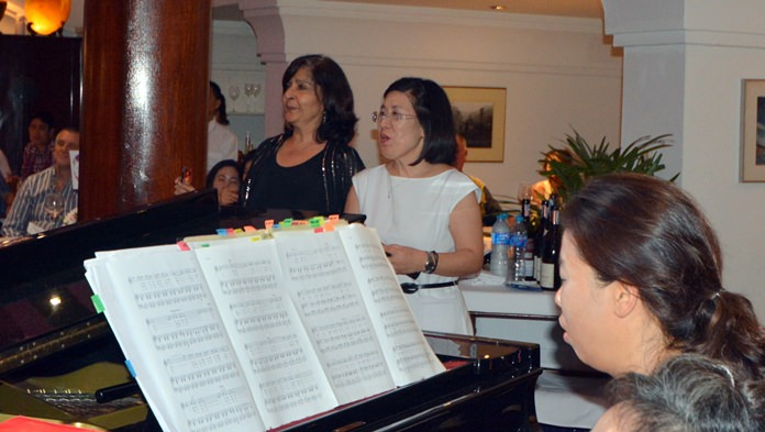Sue and Kim join in to sing the lively chorus of a favourite tune.