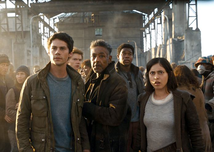 """This image shows (foreground from left) Dylan O'Brien, Giancarlo Esposito and Rosa Salazar in a scene from """"Maze Runner: The Death Cure."""" (Twentieth Century Fox via AP)"""
