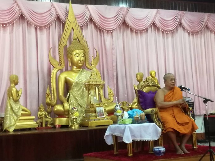"""Region 13 Ecclesiastical Gov. Phomkavee closes the fundraising drive at Chaimongkol Temple after the temple raised over 800,000 baht with their latest """"tod pha pa"""" robes-giving ceremony."""