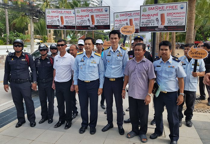 Thanet Munnoi, director of the Marine and Coastal Resource Management Office Chonburi led a squad of police officers to Jomtien Beach Feb. 1, the first day in which the three-month-old smoking ban was actually enforced.