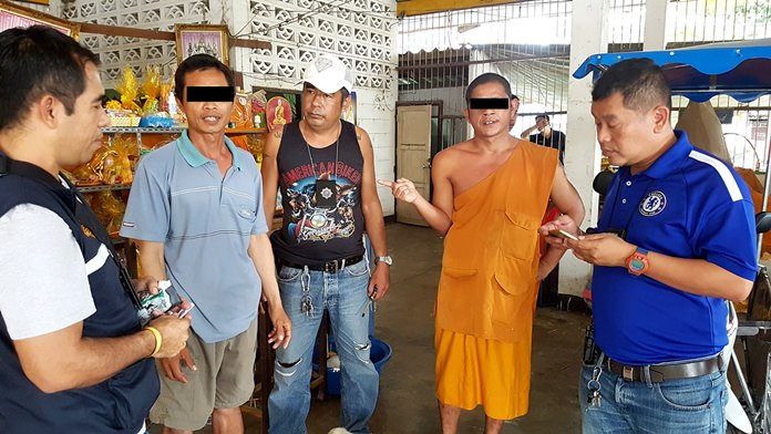 Monk Anu Boon-eiem, temple caretaker Natekom Kamolman, and Sangwal Polcharoen (not shown) were arrested on narcotics charges in Sattahip.