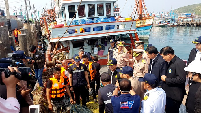 Laks Wojananwach from the Agriculture Ministry and top Fisheries Department officials inspect two Sattahip ports to ensure boats are complying with the country's regulations against potential illegal, unreported and unregulated fishing practices.