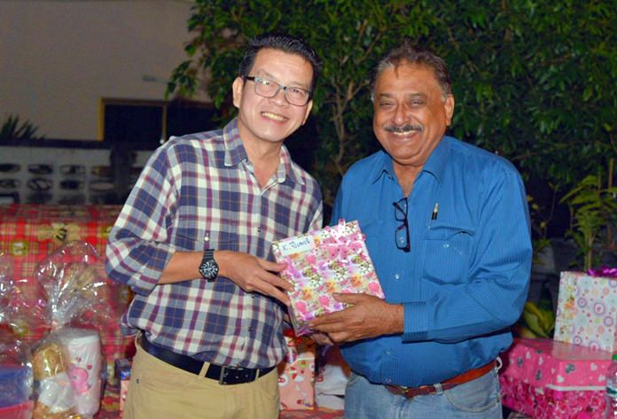 Peter Malhotra presents a special thank you gift to Nopniwat Krailerg, editor of our 3 publications.