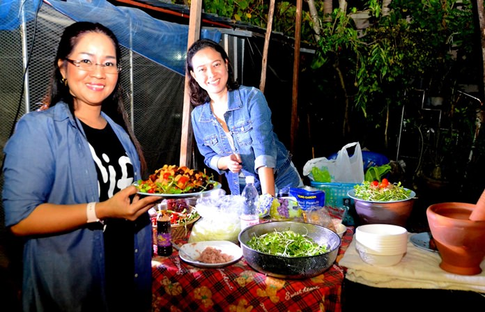Pattaya Mail HR Manager Suthasinee Maneekul and Jurairat Kanchana whip up mouth-watering somtam dishes for the guests.