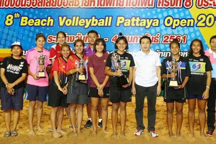 Players pose with their trophies at the conclusion of the 8th Beach Volleyball Pattaya Open at Jomtien beach, Sunday, Feb. 4.