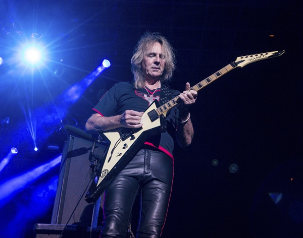 In this Oct. 24, 2015 file photo, Glenn Tipton of Judas Priest performs in San Bernardino, Calif. (Photo by Paul A. Hebert/Invision/AP)