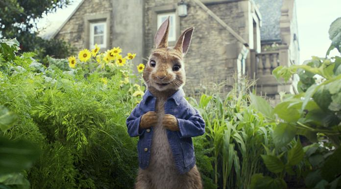 "This image released by Columbia Pictures shows Peter Rabbit, voiced by James Corden, in a scene from ""Peter Rabbit"". (Columbia Pictures/Sony via AP)"