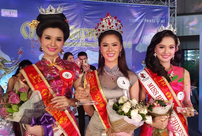 """With cash-strapped city hall passing on staging any Chinese New Year events, Pattaya shopping malls, hotels and hospitals took up the mantle for the """"year of the dog"""". It didn't stop the area's most beautiful Qipao contestants from competing, though, and Muanfan 'Bonus' Na Nan (center) was crowned Miss Qipao International at Central Festival Pattaya Beach, while Kankanit 'Bam' Mungmee earned first runner-up, and Intuorn 'Fa' Seela finished 2nd runner-up. The beach resort was filled with lion and dragon dances, contests and fun-filled events."""