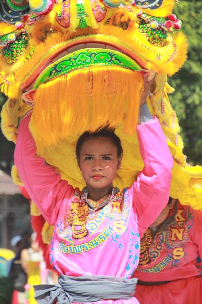 A young lady performs the lion dance.