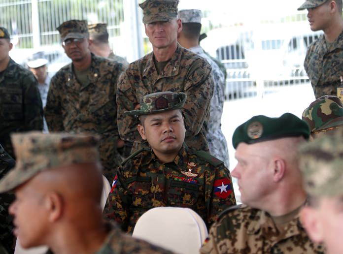 A Myanmar soldier, center, attends the opening ceremony of the joint military exercise Cobra Gold 2018 at U-Tapao Airport in Rayong Province, Tuesday, Feb. 13, 2018. Thailand and the United States have opened the largest annual joint military exercise in Southeast Asia but downplayed the presence of a Myanmar military officer. (AP Photo/Sakchai Lalit)