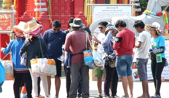 Street peddlers and hawkers are still busy on Pattaya's beaches.