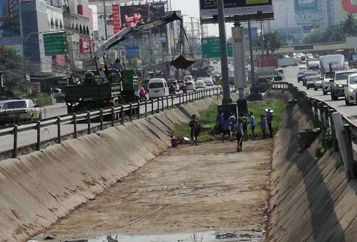 Pumps were used to drain out canals along Sukhumvit Road while engineers collected rubbish, dug up the mud and cut overgrown grass.
