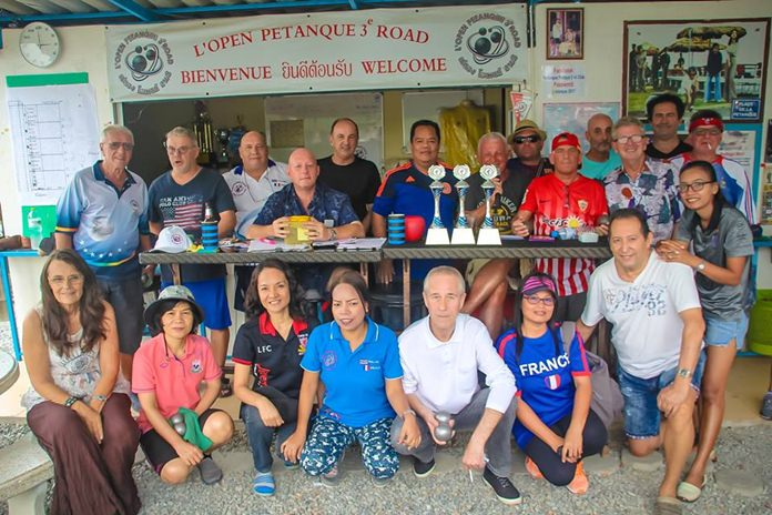 Friends of Avenin Daniel pose for a group photo during the charity pentanque tournament held in his memory.