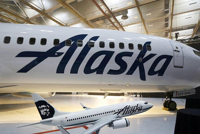 FILE - An Alaska Airlines flight to Seattle was forced to return to Anchorage, Alaska, early Wednesday, Feb. 7, 2018, after a passenger locked himself in the bathroom, took off all his clothes, and refused to follow crew instructions. (AP Photo/Ted S. Warren)