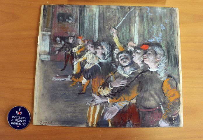 This photo provided by French Customs shows a stolen painting by French painter Edgar Degas. (Marc Bonodot/French Customs via AP)