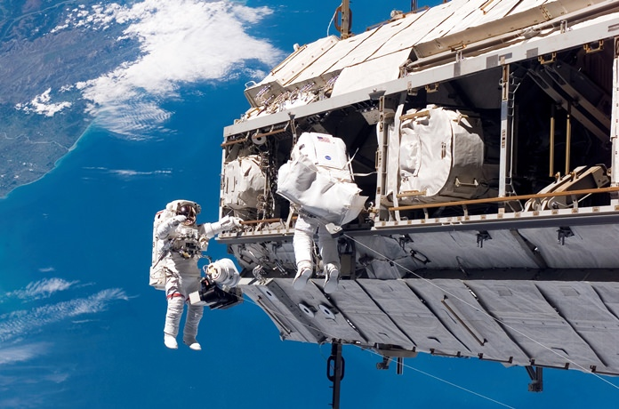 FILE - In this Dec. 12, 2006, file photo, made available by NASA, astronaut Robert L. Curbeam Jr., left, and European Space Agency astronaut Christer Fuglesang, participate in a spacewalk during construction of the International Space Station. Under President Donald Trump's 2019 proposed budget released, Monday, Feb. 12, 2018, U.S. government funding for the space station would cease by 2025. (NASA via AP, File)