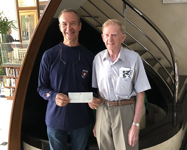 Michael presenting his donation to Lewis Underwood for this year's Jester's charity drive.