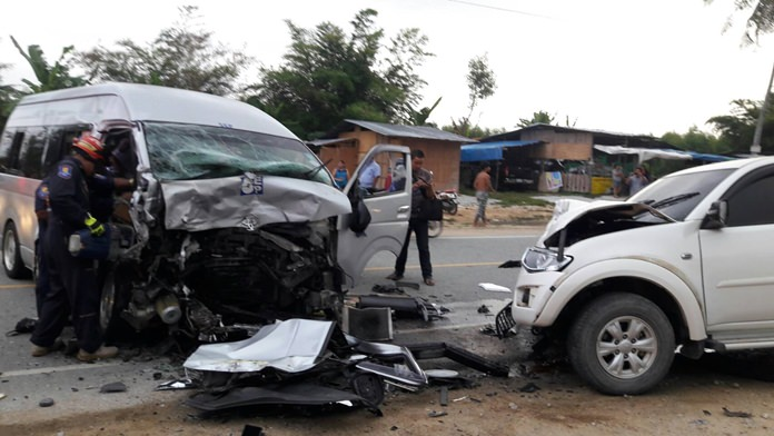 Thirteen people were injured when an employee-shuttle van collided with a pickup truck in Huay Yai.